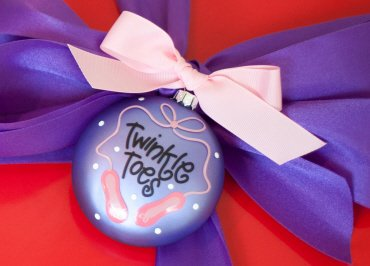 Coton Colors Painted Christmas Ornaments, Dance Ballet 90mm Glass Ornament, the Glass 90mm Oval Ballet Ornament Is Designed with Ballet Shoes Accented By Artistic Twinkle Toes Writing on the Front and Features a Dance Bag on the Back.