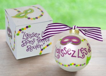 Coton Colors Painted Christmas Ornaments. The 100mm Round Glass Mardi Gras Good Times Roll Ornament Is Designed with Masks in Traditional Mardi Gras Colors and Features Artistic French Laissez Les Bons Temps Rouler Writing That Wraps Around the Ornament.