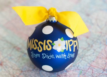 Coton Colors Painted Christmas Ornaments. The 100mm Round Glass Mississippi Statement Ornament Is Designed with a Polka Dot Pattern Accented By Artistic Mississippi From Dixie, with Love Writing.