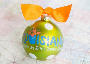 Coton Colors Painted Christmas Ornaments. The 100mm Round Glass Louisiana Statement Ornament Is Designed with a Polka Dot Pattern Accented By Artistic Louisiana Laissez Les Bon Temps Rouler Writing.