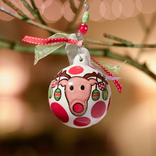 Glory Haus Decorated Reindeer Ball Ornament. Rudolf Takes on a Whimsical Style While Being Decorated with Lights on This Porcelain Ball Christmas Ornament. An Adorable Gift to Give! Comes with a Decorative Ribbon.