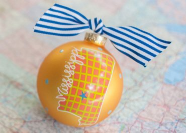 Coton Colors Painted Christmas Ornaments. The 100mm Round Glass Mississippi in a Colorful State Ornament Is Designed with a Check Patterned State Shape Accented By Artistic Mississippi Writing.