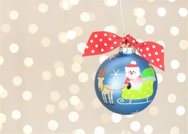 Coton Colors Painted Christmas Ornaments. The 100mm Round Glass Santa Is Claus Coming to Town Ornament Is Designed with Santa, Rudolph and His Sleigh on the Front and Features Carol-inspired Writing on the Back.