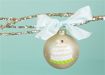 Coton Colors Wedding Painted Christmas Ornaments. The 100mm Round Glass Wedding Cake Ornament Is Designed with a Tiered Cake Topped with Icing and a Bride and Groom and Features Artistic Writing on the Back.
