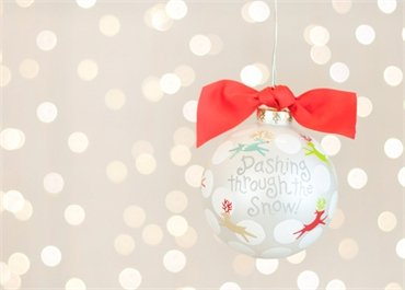 Coton Colors Painted Christmas Ornaments. Bright and Playfully Modern Reindeer Prance Across a Crisp White Reflection of Snow on This Carol-inspired Dashing Through the Snow Ornament. Perfect for Holiday Gift Giving to Make Recipients Hum Along with Happiness.