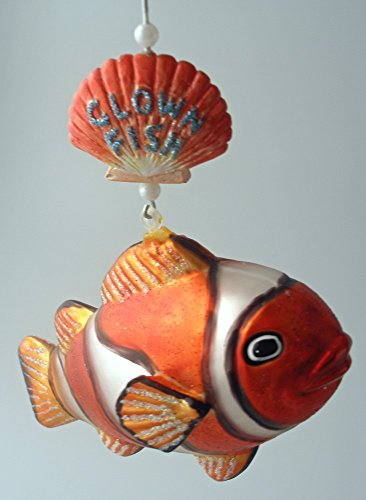 December Diamonds Handpainted Glass Clown Fish Ornament Hangs from a Sea Shell & is is approximately 6 inches long.Blown Handpainted Glass Ornament