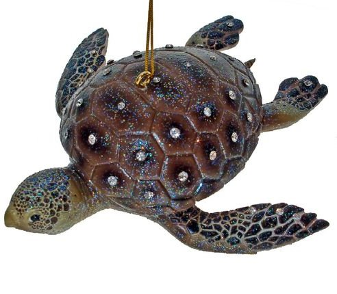 December Diamonds Discontinued Aquatic Collection Sea Turtle Ornament is embellished with Clear Rhinestones & Sparkles. Now a Collector's Item This Aquatic Collection Ornaments are made of resin & arrive in a gift box. Ready to hang on a gold cord. A Collector's Item!!!