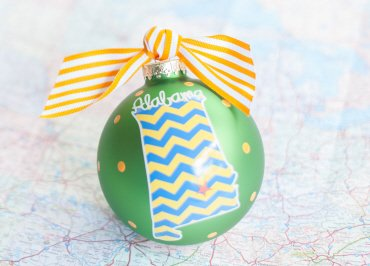 Coton Colors Chevron Painted Christmas Ornaments. The 100mm Round Glass Alabama in a Colorful State Ornament Is Designed with a Chevron Patterned State Shape Accented By Artistic Alabama Writing.