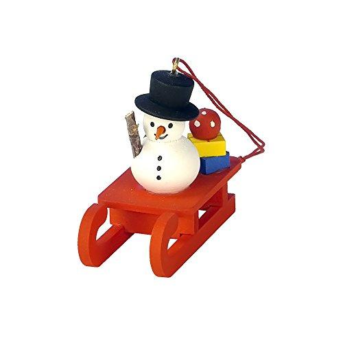"10-0432 – Christian Ulbricht Ornament – Snowman on Sled – 2″""H x 1″""W x 2″""D"