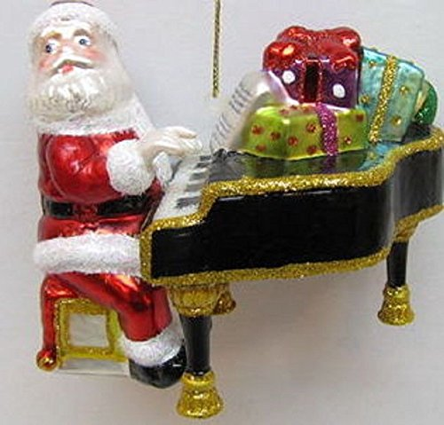 December Diamonds Santa Playing his Baby Grand Piano is a Blown Glass & Hand painted Ornament. Ready to Hang on a Gold Cord.Retired Limited Edition!