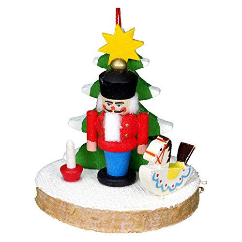 "10-0814 – Christian Ulbricht Ornament – Nutcracker with Tree and Toys – 2″""H x 2″""W x 1.75″""D"