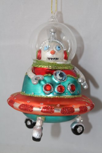 December Diamonds Blown Glass Robot in a Glass Space Vehicle with Wheels…Fun,Colorful, & approximately 4 inches Tall. An Ornament that will fascinate your Child:)