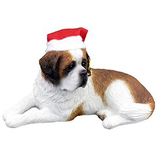 Sandicast Saint Bernard Lying Wearing a Santa Hat – Christmas Holiday Ornament (XSO13501)