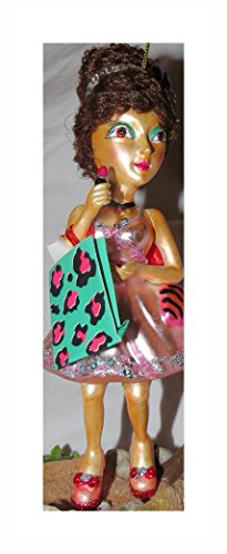 "December Diamonds Girly Girl with Dark Brown ""Real"" Hair in a 1960's Bee Hive Holding a Pink Lipstick Ornament.Hand Painted Blown Glass & Approximately 5.5 inches Long.. Red Fabric Bow on her Dress."