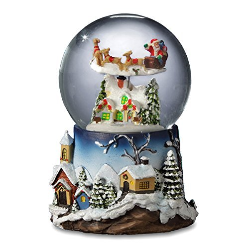 Santa Flying Over Village Snow Globe
