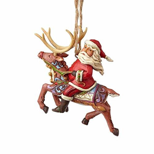 Enesco Jim Shore Heartwood Creek Santa Riding Reindeer Ornament